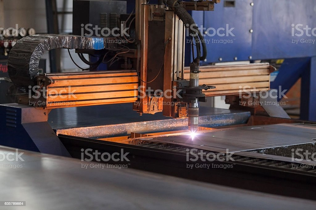 closeup of the automatic plasma robot in the course  metal stock photo