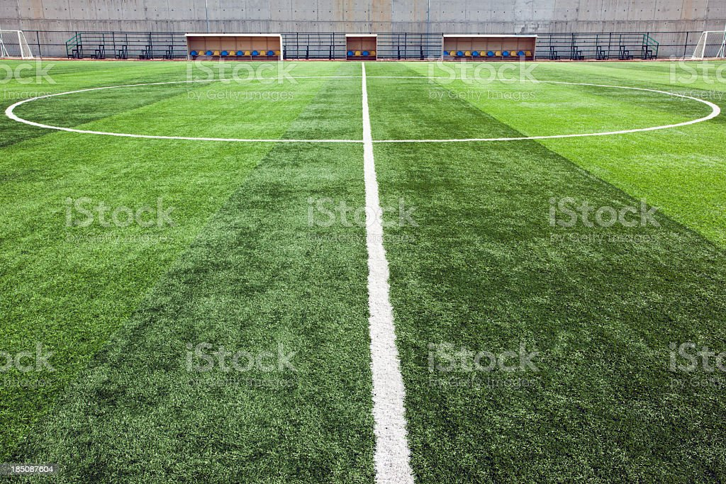 Close-up of the center line of soccer field stock photo