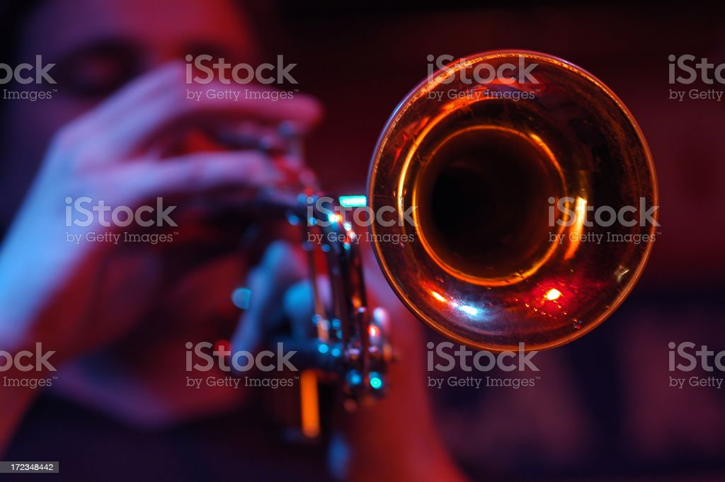 Close-up of the cone of a trumpet with player out of focus stock photo