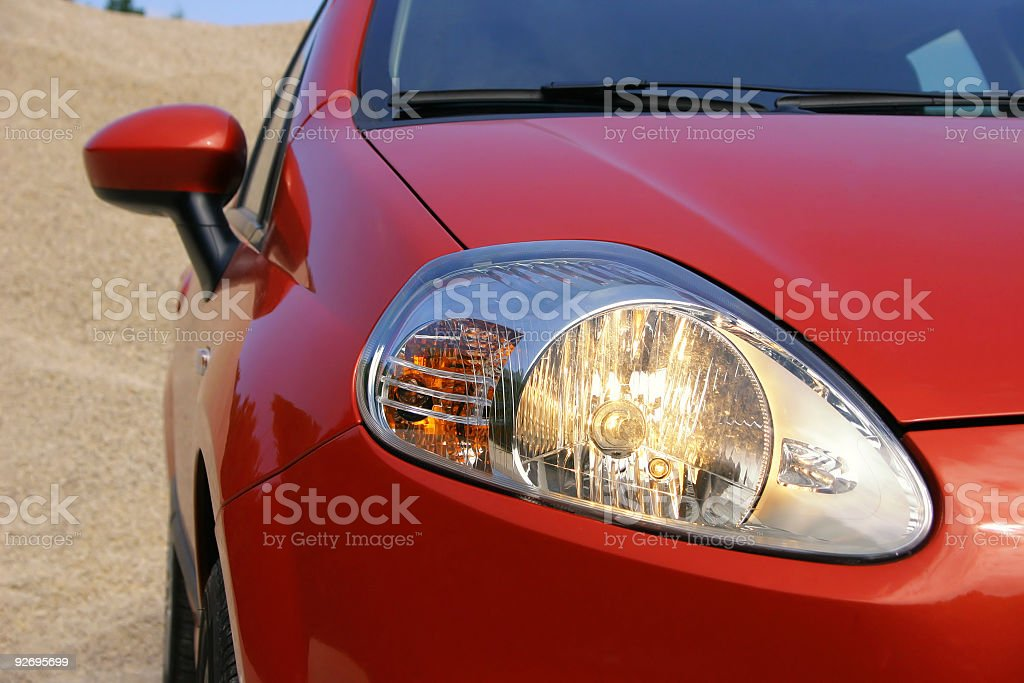 Close-up of the driving lights on a red compact car royalty-free stock photo