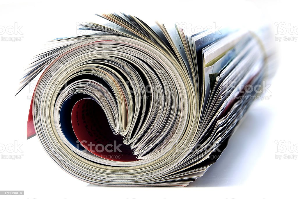 Close-up of the end of a magazine rolled up royalty-free stock photo