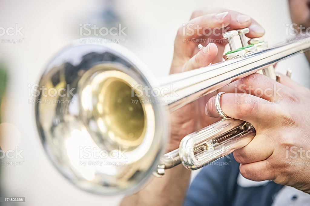 Close-up of the end of a trumpet being played by a musician stock photo