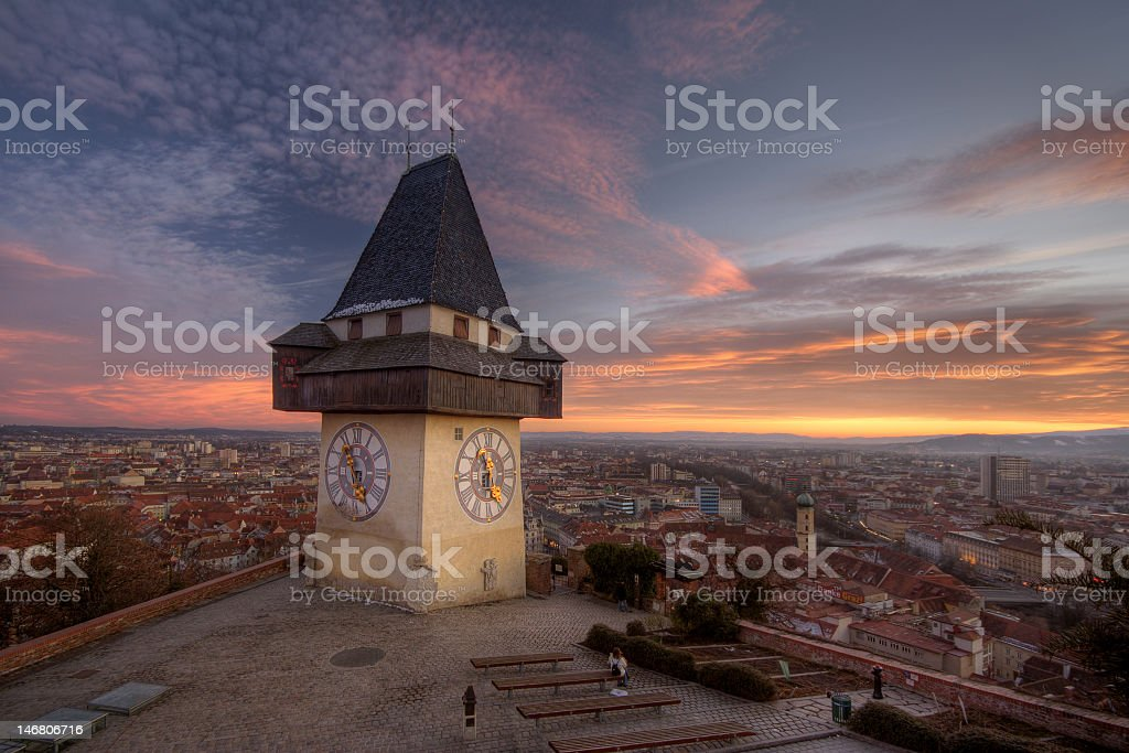 Close-up of the Graz clock tower view over a cityscape stock photo