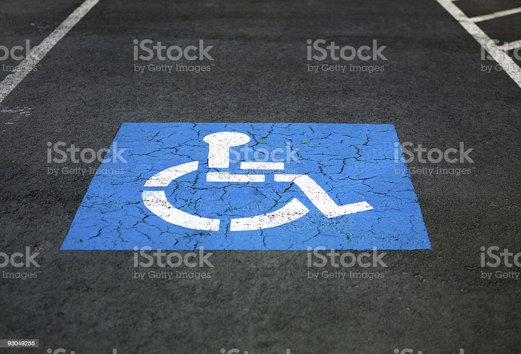 A close-up of the handicap painting on a parking spot stock photo