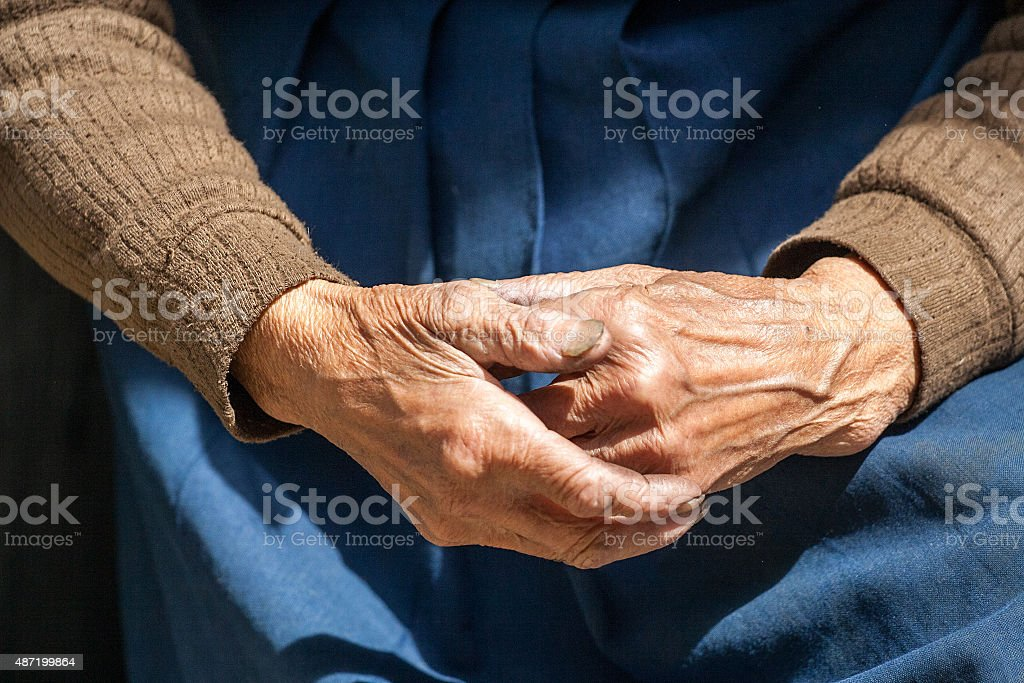 Closeup of the hands of elderly woman stock photo