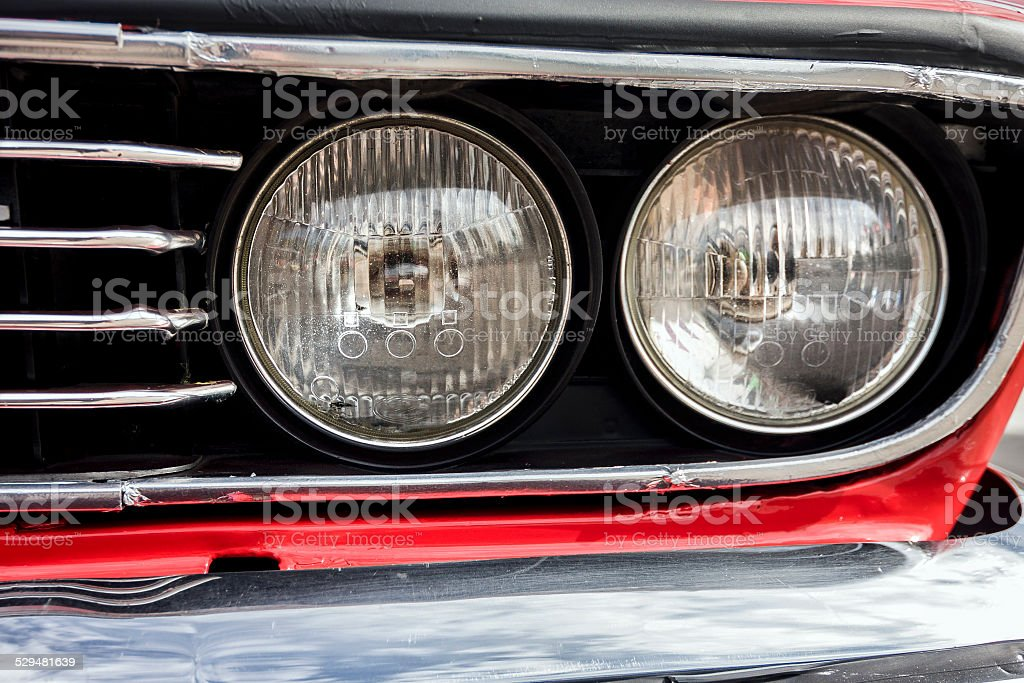 Closeup of the headlights of car stock photo