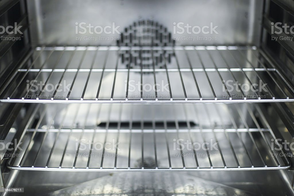 A close-up of the interior of a clean oven stock photo