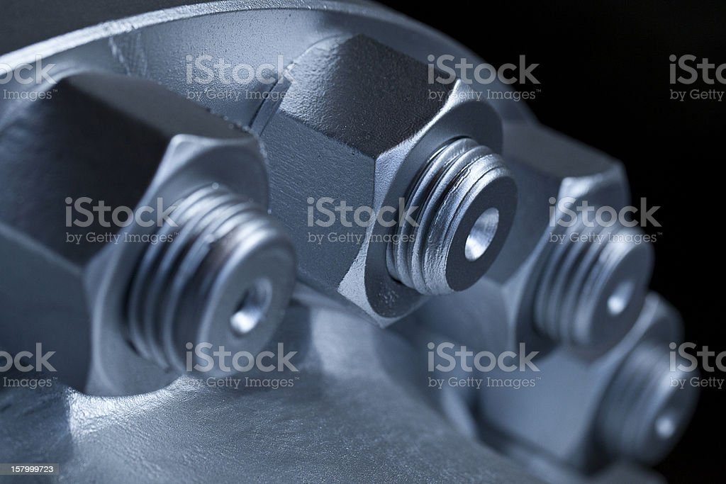 Close-up of the joint of two flanges by bolts and nuts royalty-free stock photo