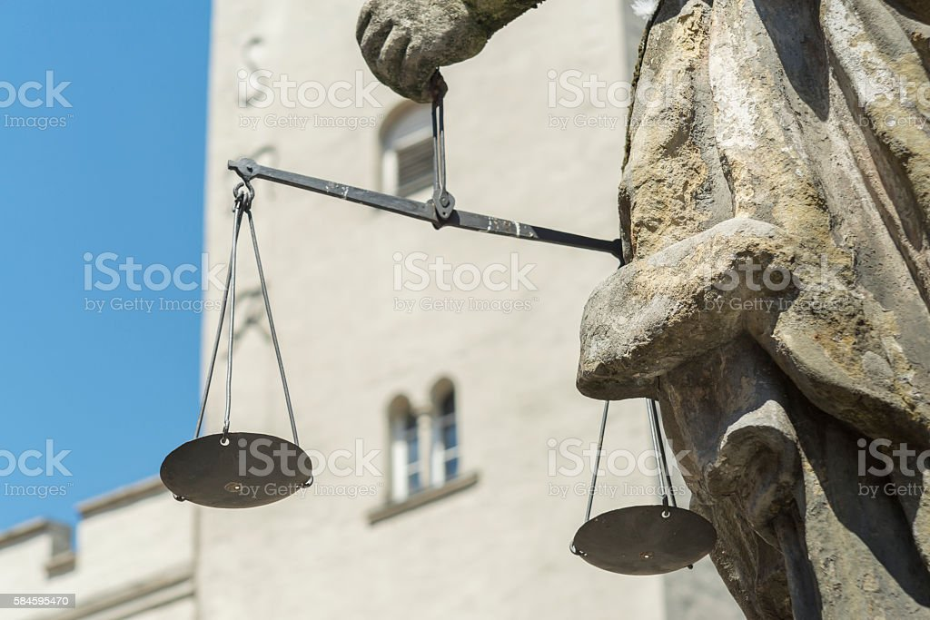 Closeup of the Justitia well in Regensburg with scales stock photo