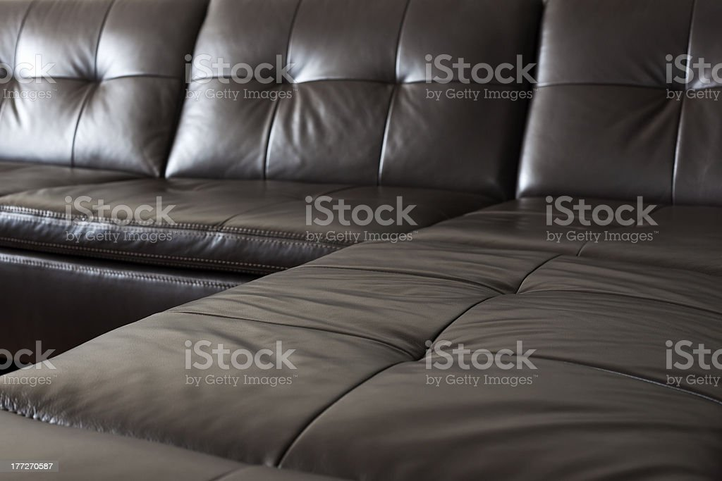 A close-up of the large black leather sofa royalty-free stock photo