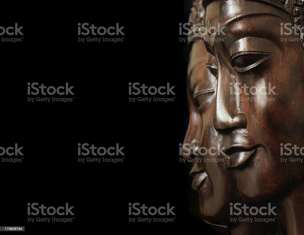 Closeup of the men's and women's wooden faces royalty-free stock photo
