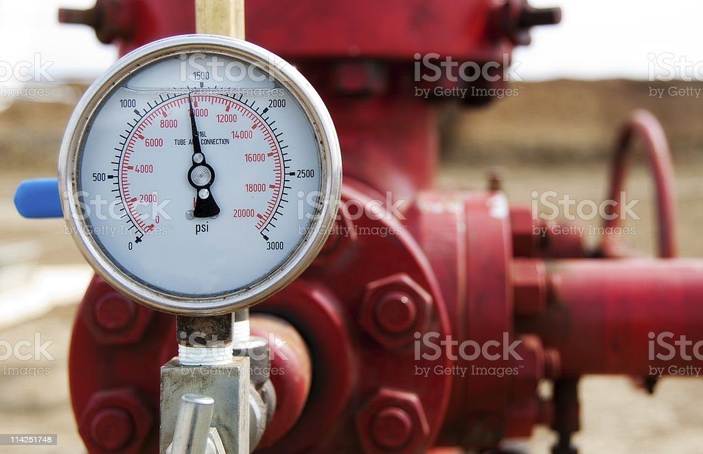 Close-up of the meter of a red wellhead pressure gauge stock photo