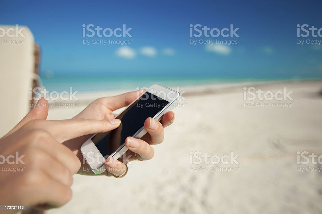 close-up of the phone in female hands royalty-free stock photo