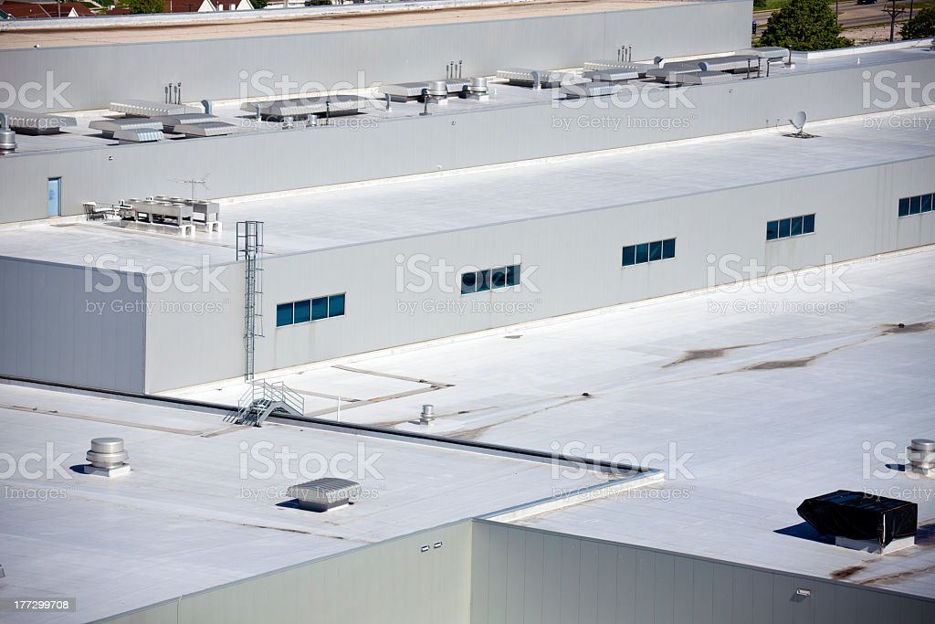 Close-up of the roof of big warehouse building stock photo