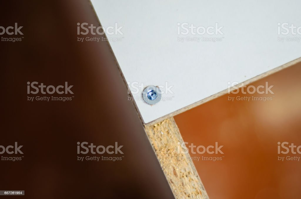 Close-up of the screw in a chipboard furniture stock photo
