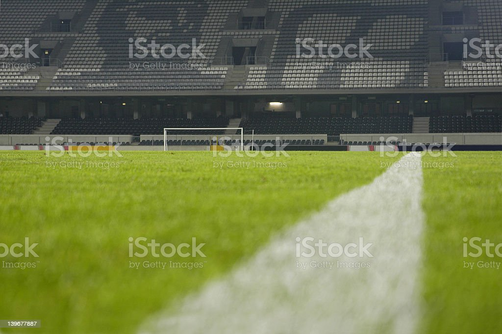 Close-up of the sideline marking paint on a soccer field royalty-free stock photo