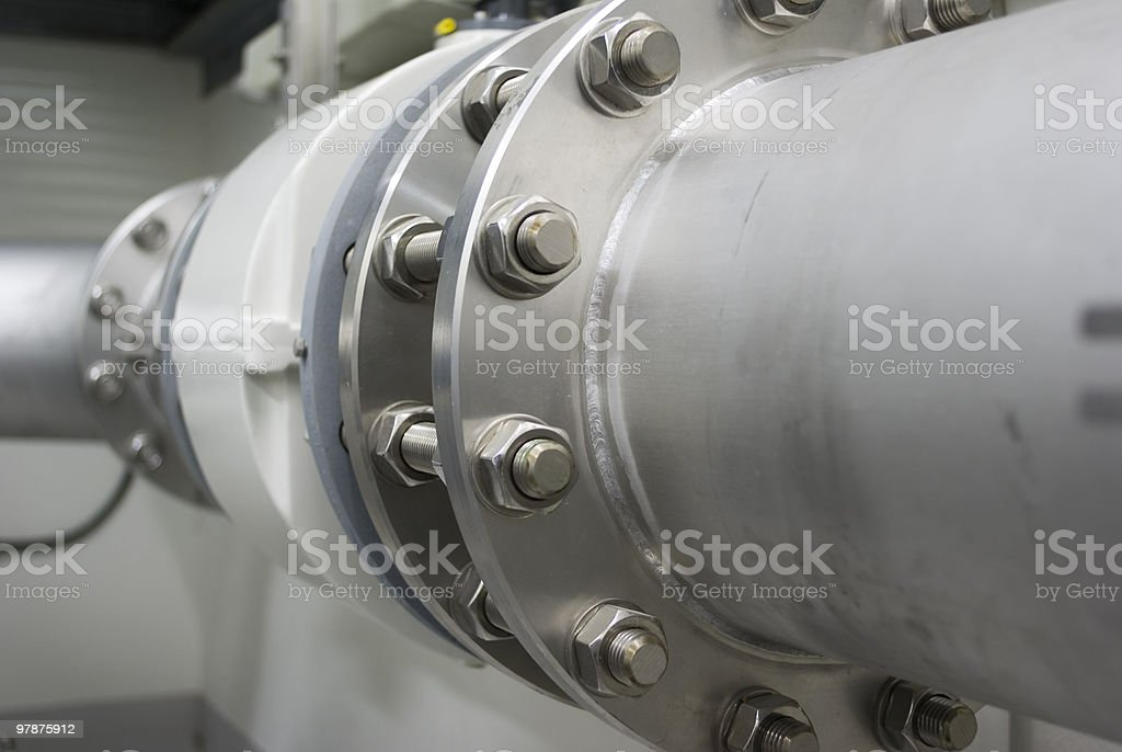 Closeup of the spot where two pipes connect stock photo