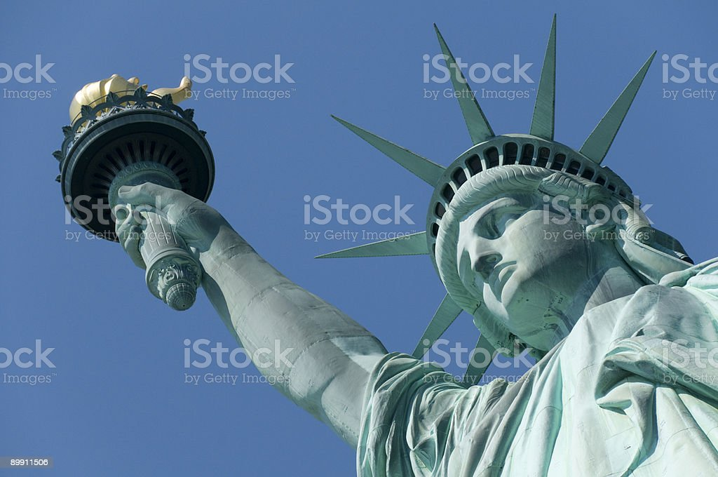 Close-up of the Statue of Liberty with a blue background stock photo