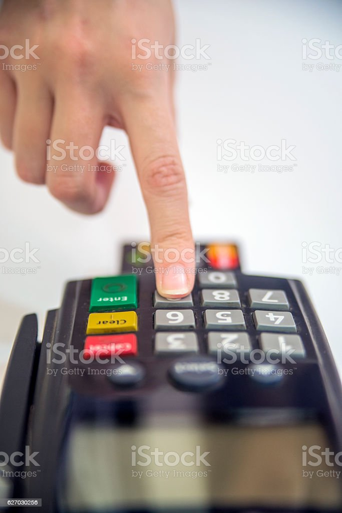 Close-up of the terminal. POS terminal in hands. stock photo