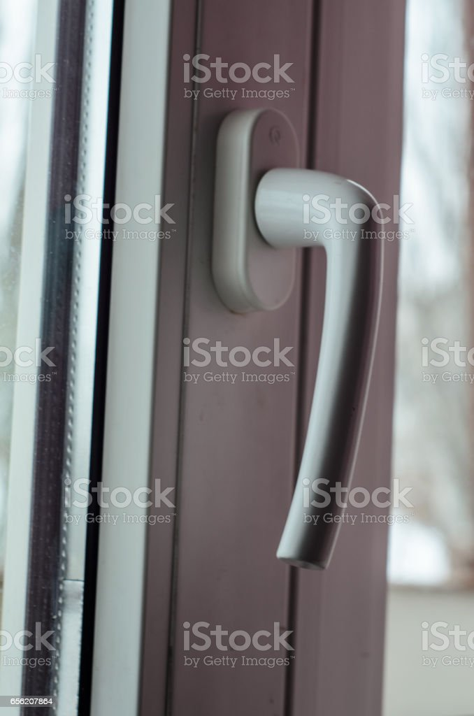 Close-up of the window handle stock photo