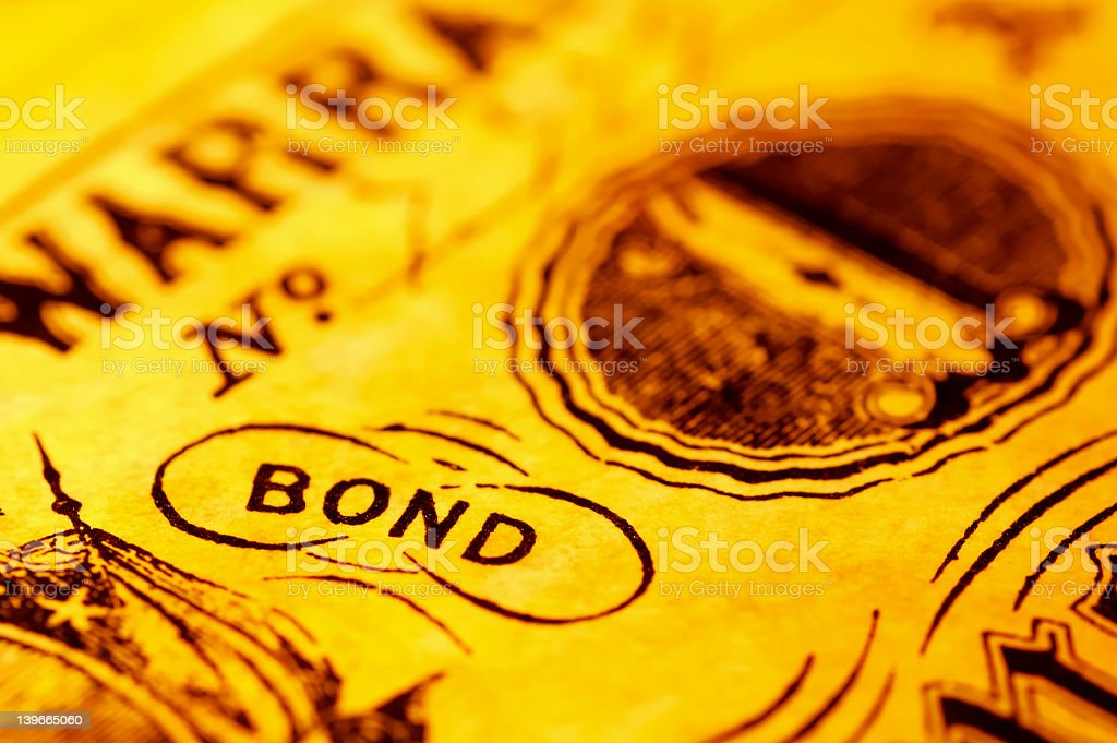 A close-up of the word bond with a yellow tint stock photo