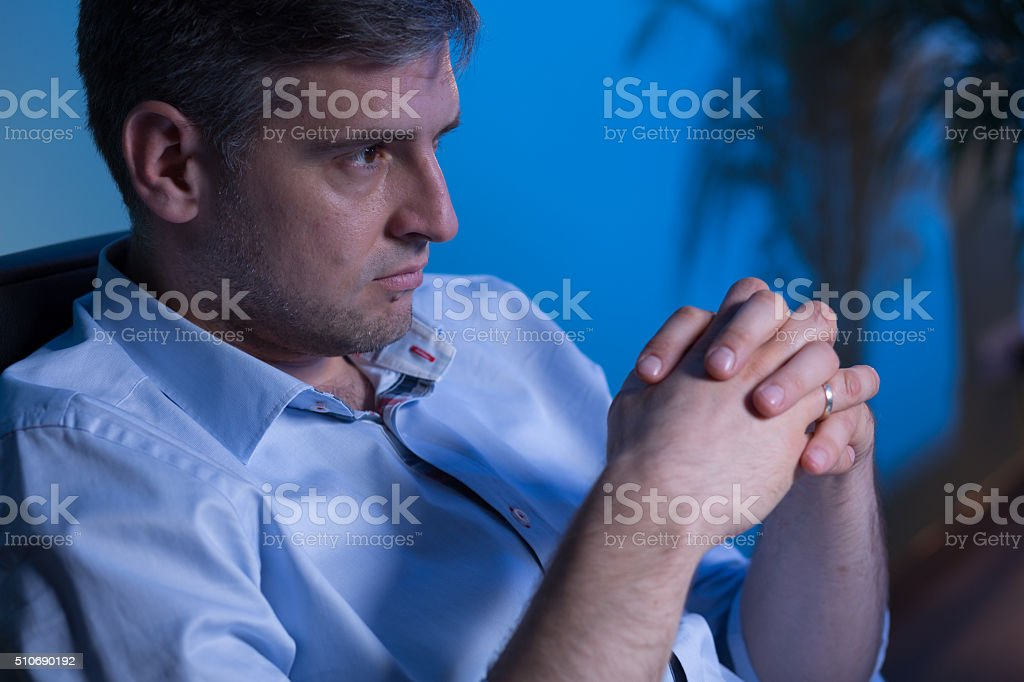 Close-up of thoughtful businessman stock photo