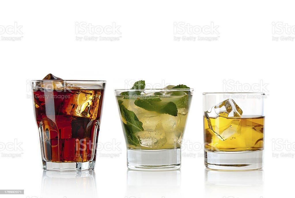 Close-up of three classic cocktail drinks in different sizes stock photo