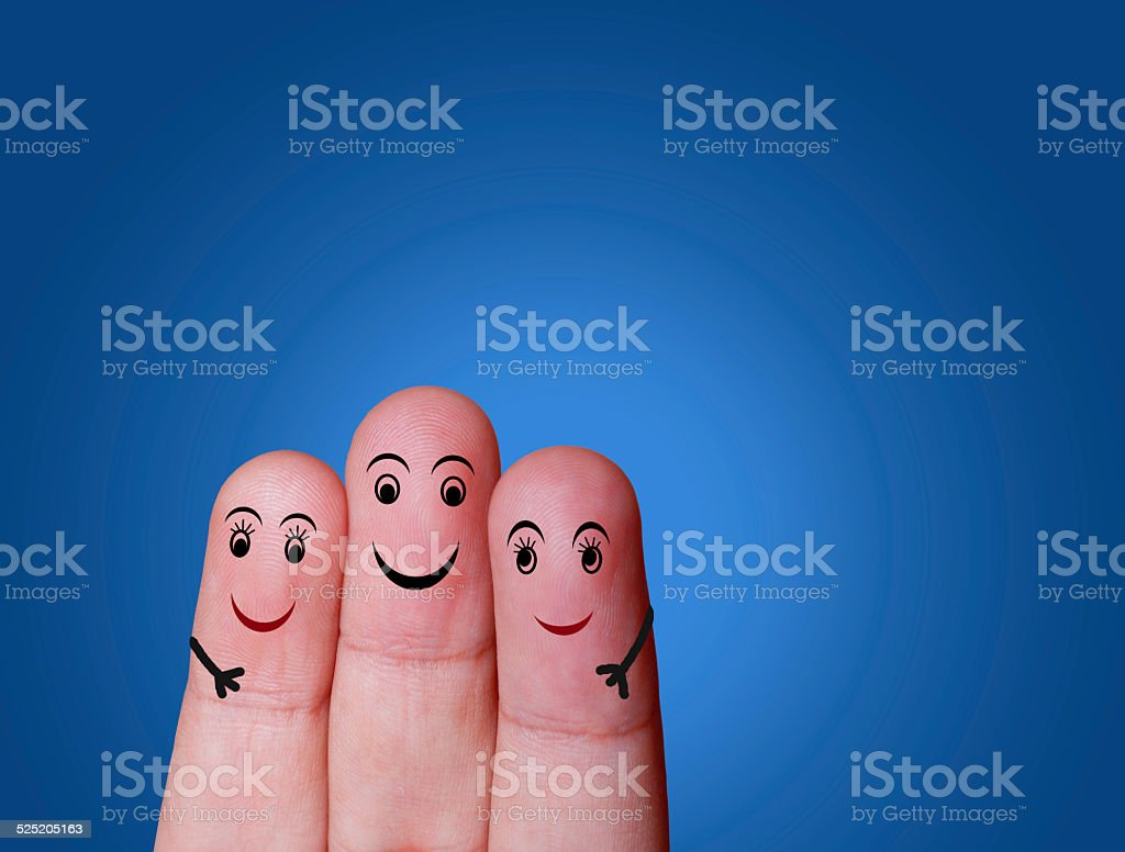 Close-up of three fingers painted with smiley face stock photo