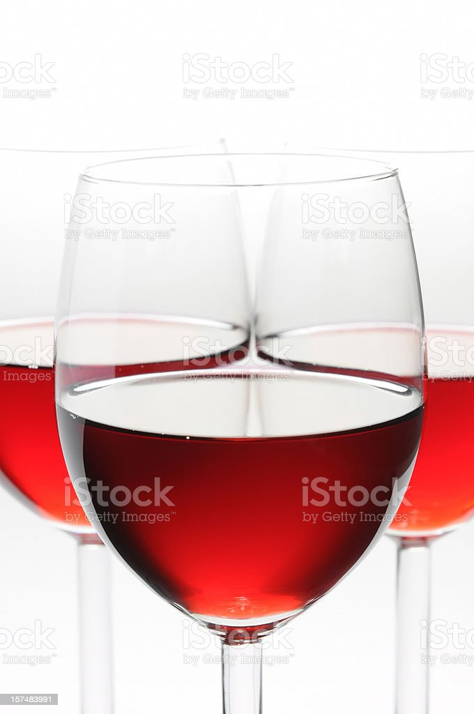 Close-up of three glasses of red wine, isolated, side view royalty-free stock photo