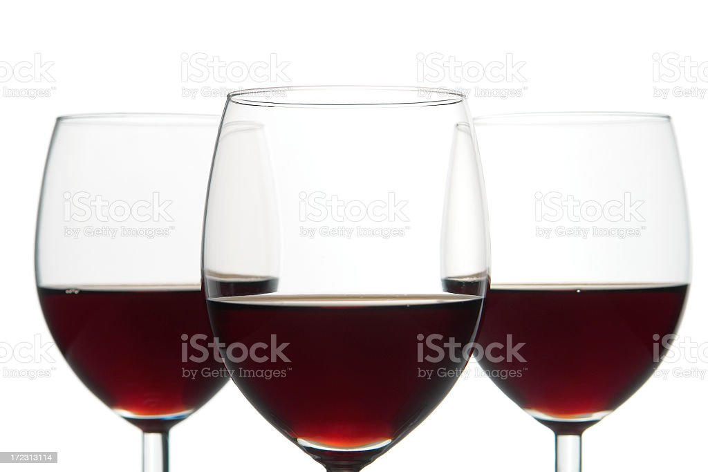 Close-up of three glasses of red wine, isolated, studio shot stock photo