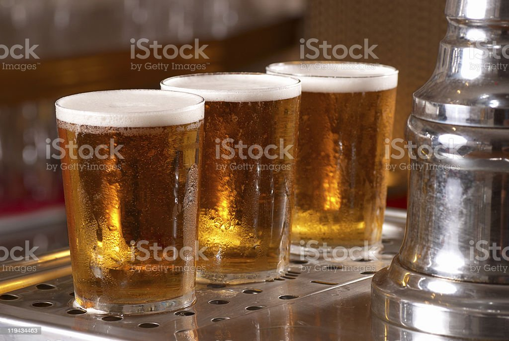 Close-up of three golden pints of draft beer royalty-free stock photo