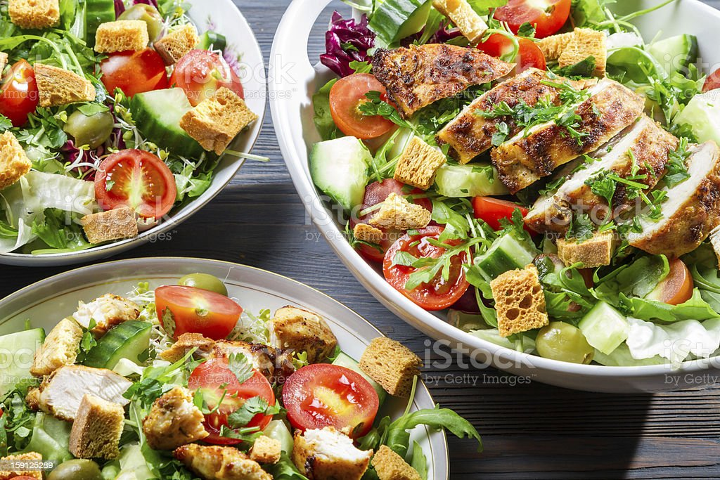 Closeup of three healthy salads with vegetables stock photo