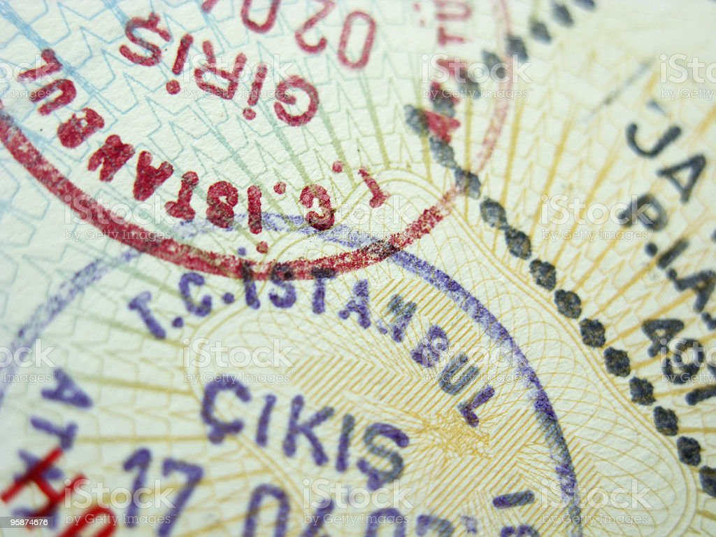A close-up of three passport stamps for different countries stock photo