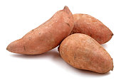 Close-up of three Raw sweet potatoes