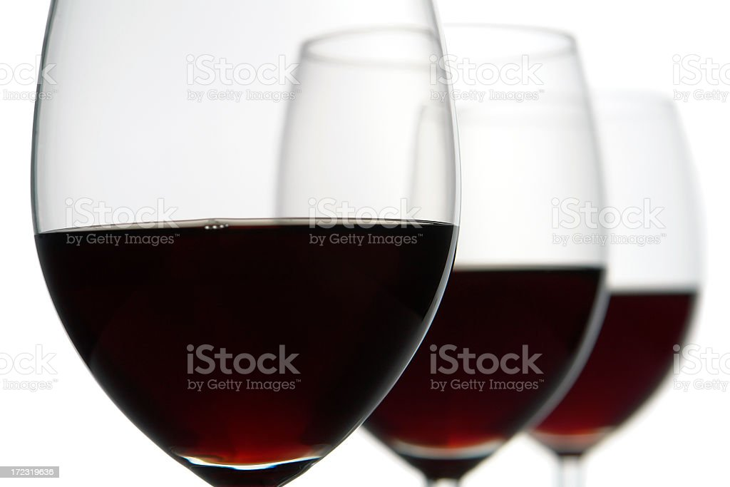 Close-up of three red wine glasses, isolated white, studio shot royalty-free stock photo