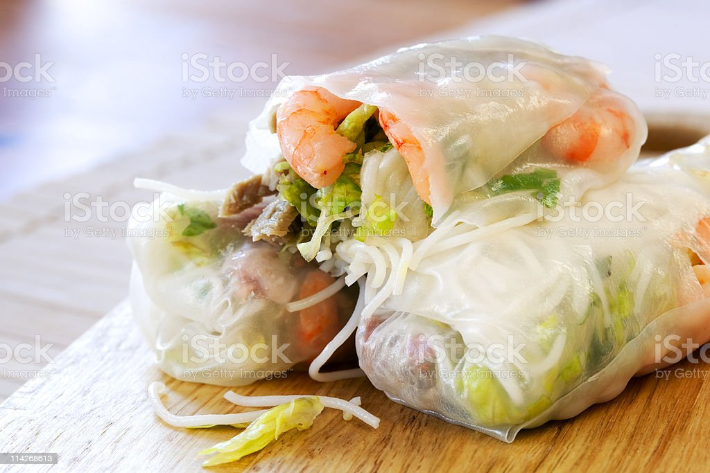 Close-up of three seafood and vegetables rice paper rolls stock photo