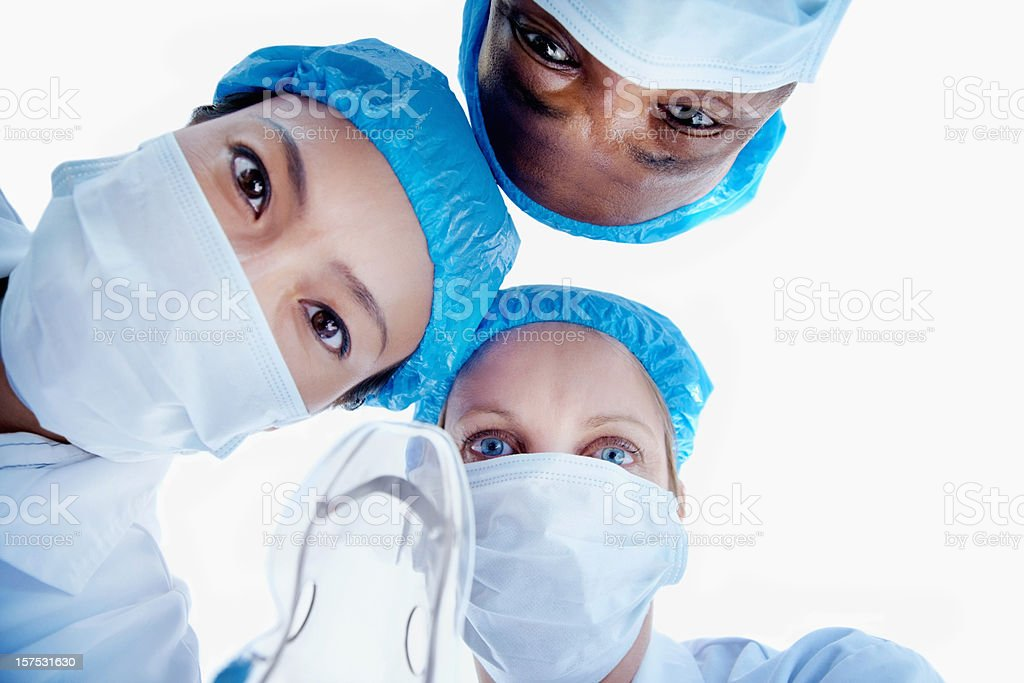Close-up of three surgeons during an operation royalty-free stock photo