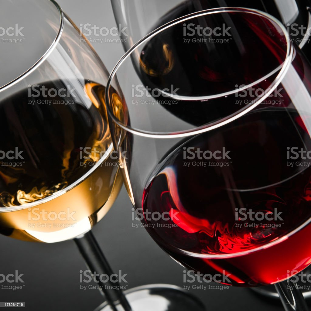 Close-up of three white, red, rose wine glasses royalty-free stock photo