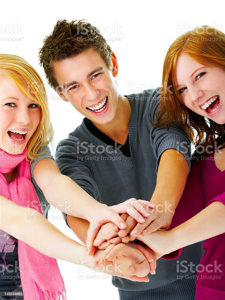 Close-up of three young people joining their hands royalty-free stock photo