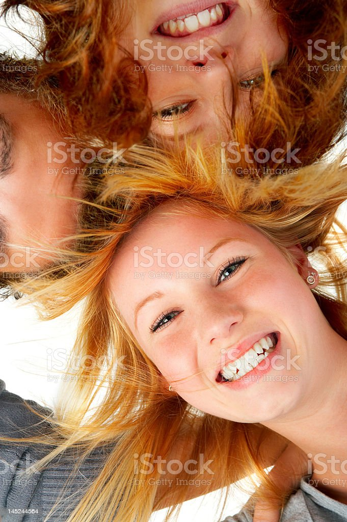 Close-up of three young people smiling stock photo
