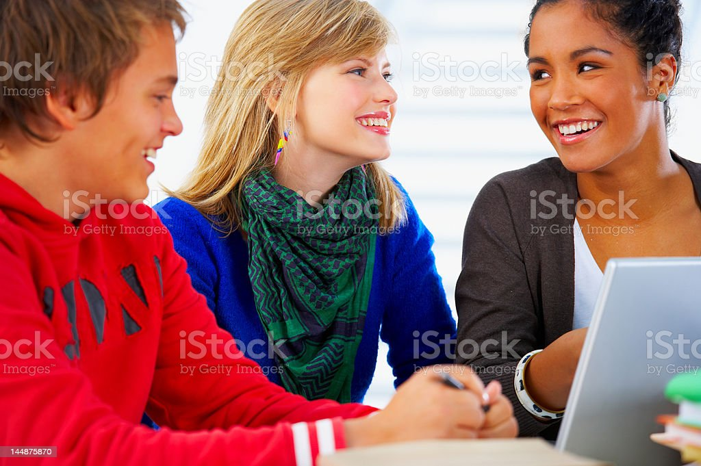 Close-up of three young students smiling royalty-free stock photo
