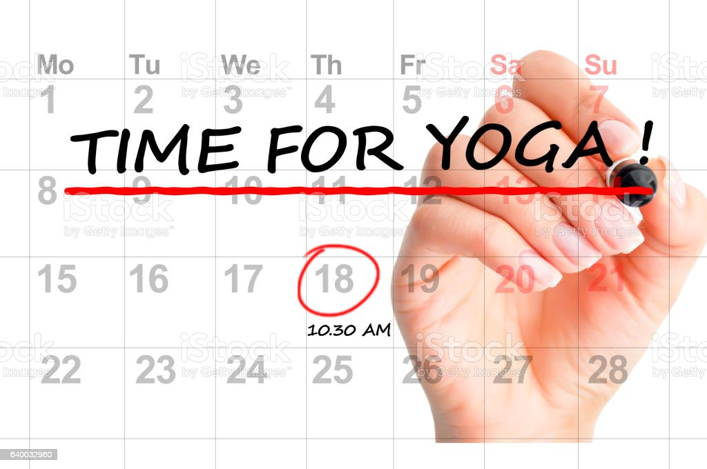 """Close-up of """" Time for yoga"""" text on calendar stock photo"""