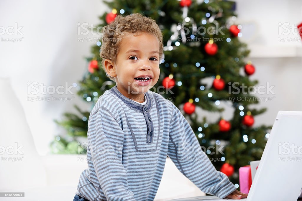 Close-up Of Toddler Using A Laptop At Christmas stock photo