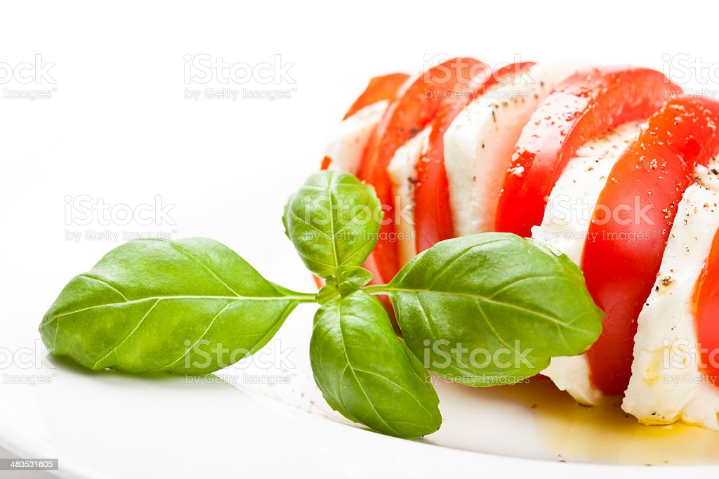 Close-up of Tomato and Mozzarella with Basil Leaf royalty-free stock photo