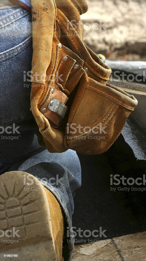 Close-up of tool belt hanging in technician's waist stock photo