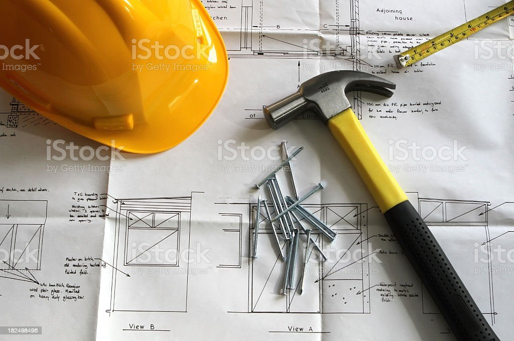 A close-up of tools on a home extension blueprint royalty-free stock photo