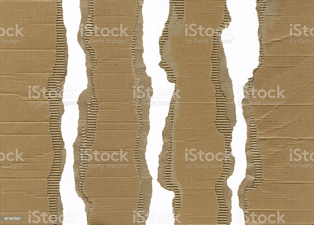 Close-up of torn cardboard paper revealing white background royalty-free stock photo
