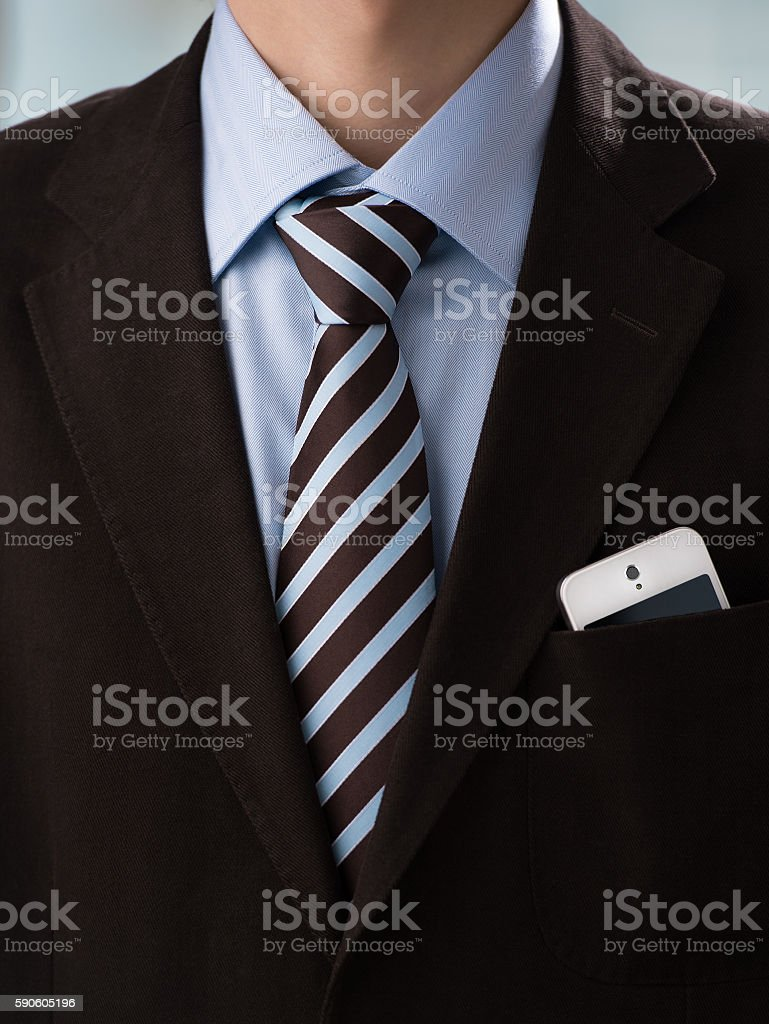 Closeup of torso of confident business man wearing elegant suit stock photo