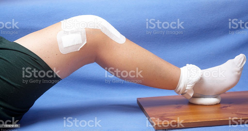 Closeup of total knee replacement patient exercising stock photo