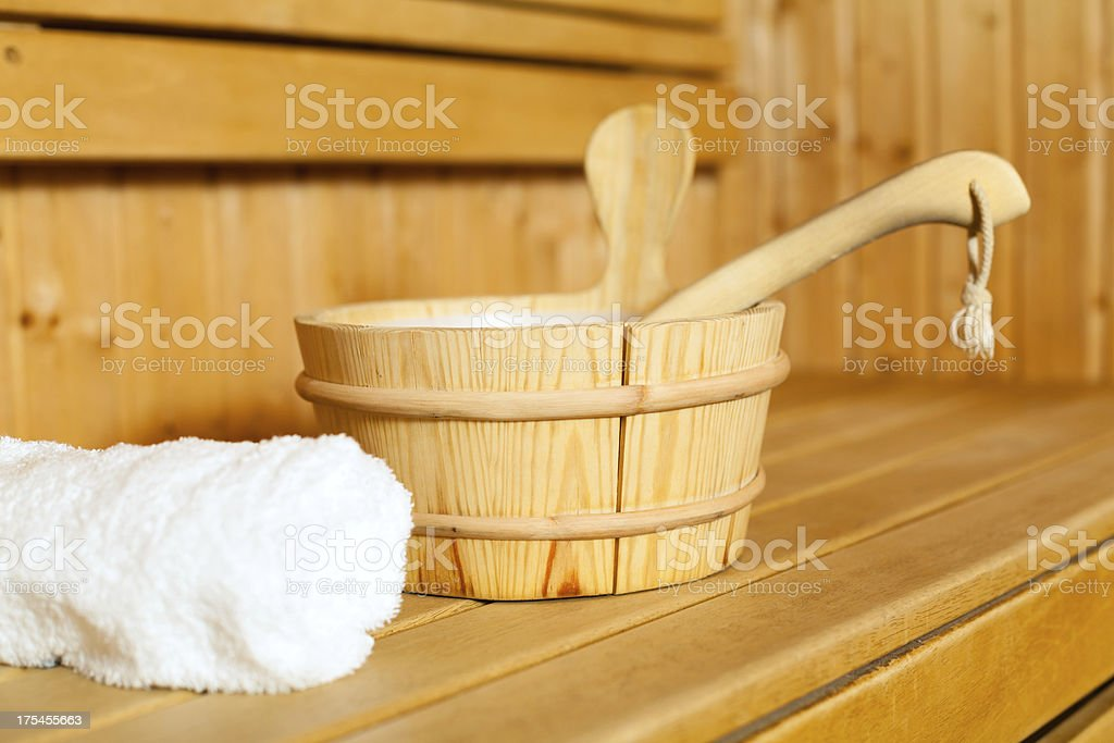 Close-up of towel, bucket and ladle in sauna stock photo